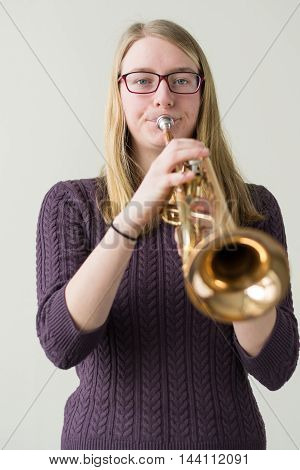 Teenager playing with a trumpet - focal point Girl