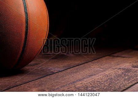 Image of a basketball on hardwood surface