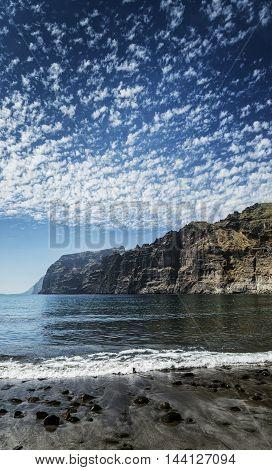 los gigantes cliffs natural famous landmark and volcanic black sand beach in south tenerife island spain
