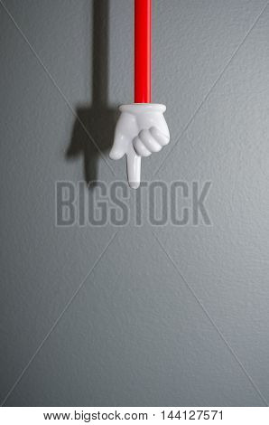 Image of a white plastic hand pointing down