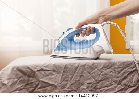 domestic chores - ironing clothes on ironing board