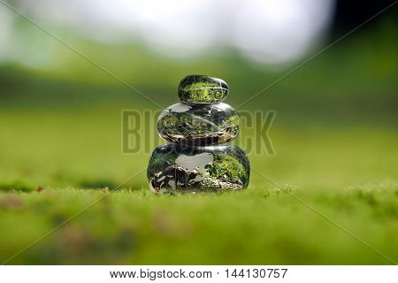 Transparent stones on a green moss. Concept - peace of mind. Environment. The harmony of the inner world
