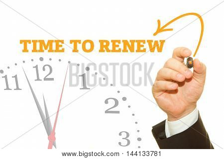 Businessman hand writing TIME TO RENEW message on a transparent wipe board.