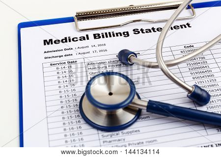 Medical cost concept with stethoscope and medical bill