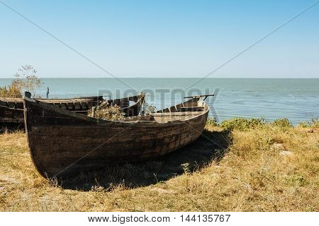 Lake holiday fishing old boat summer sunrice on water