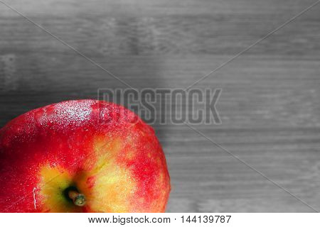 A Ripe Red Apple fruit on a wooden background