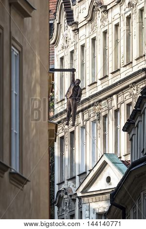 Prague Czech Republic - May 28 2016: View of street in old town and the Hanging Man sculpture dedicated to Sigmund Freid made by sculptor David Cerny.