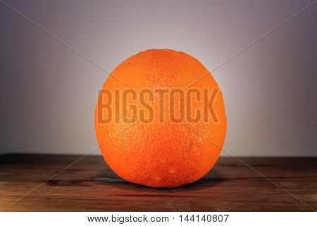 Ripe Orange fruit on a wooden background and isolated