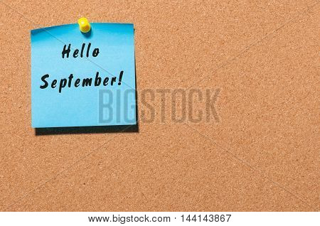 Hello September wrote at paper pinned to notice board. Autumn time concept.