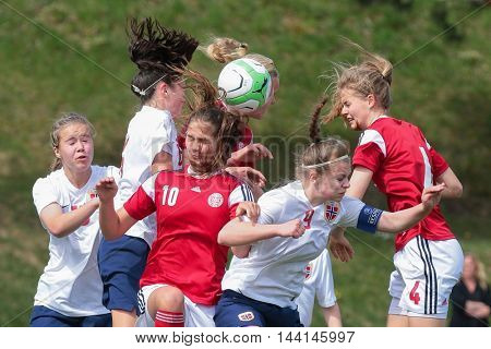 LINDABRUNN, AUSTRIA - APRIL 13, 2015: Mille Gejl (#4 Denamrk) and Ingrid Kvernvolden (#6 Norway) fight for the ball during a UEFA women's U17 qualifying game.
