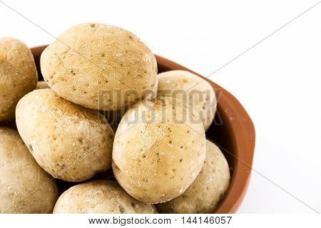 Canarian potatoes (papas arrugadas) isolated on white background