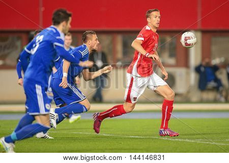 VIENNA, AUSTRIA - MARCH 31, 2015: Ermin Bicakcic (#3 Bosnia-Herzegowina) and Marc Janko (#21 Austria) fight for the ball during an European Championship qualifying game.