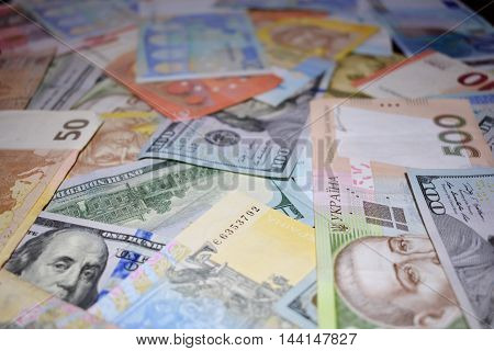 money raskidanaye on the table, euros, dollars, hryvnia