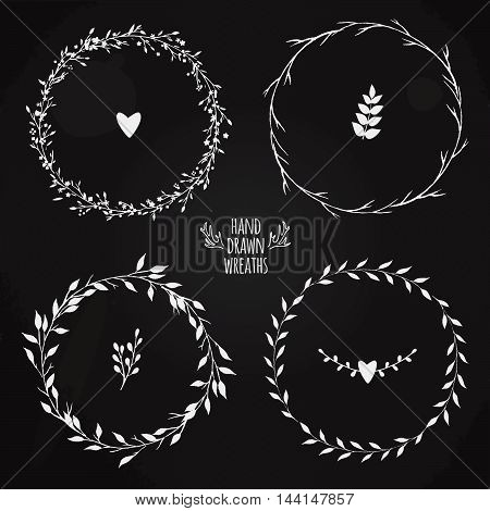 hand drawn floral wreaths on a chalkboard, vector floral wreath, vintage style