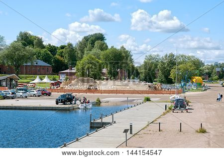 LAPPEENRANTA, FINLAND - AUGUST 8, 2016: View of The Knight Sandcastle near Saimaa Lake from pavilion with observation deck.