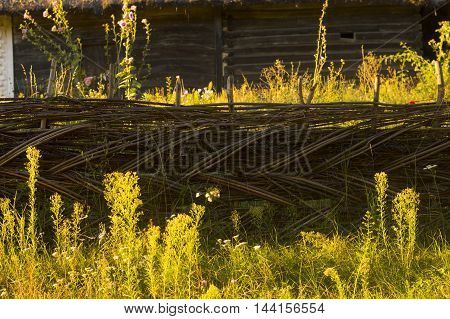 Braided Fence of Old Rural Farmhouse Stock Photo