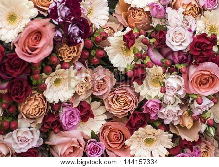 Bouquet with roses and Gerbera daisy in red and creme