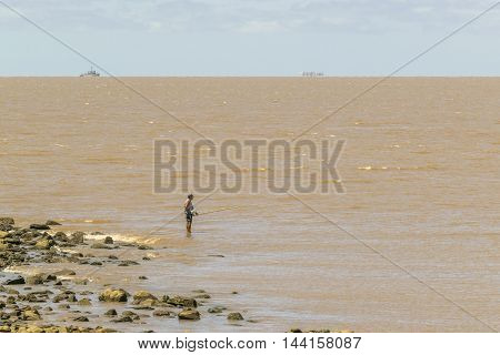 MONTEVIDEO, URUGUAY, - DECEMBER - 2015 - Adult fisherman fishing at river in Montevideo Uruguay