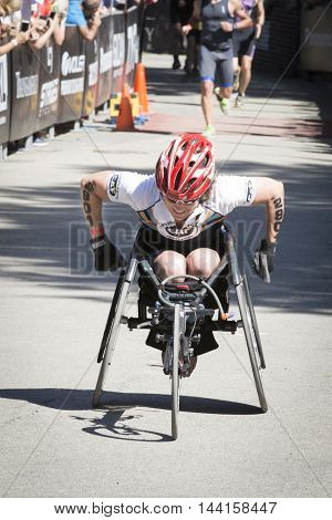 NEW YORK JUL 24 2016: ParaTriathlete from CAF, Challenged Athletes Foundation, nears the finish line in Central Park. The NYC Triathlon Race is the only International Distance triathlon in the city.