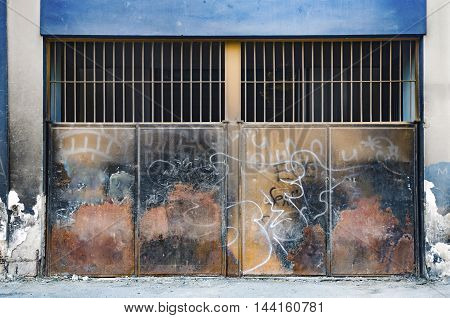 Rusty metal, ferrous metal plate used for security purposes. Background