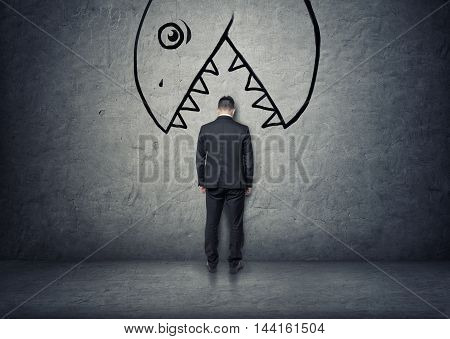 Back view of a businessman with his head between teeth of a bug hand drawn monster to eat him. Misfortune and bad luck. Business staff.