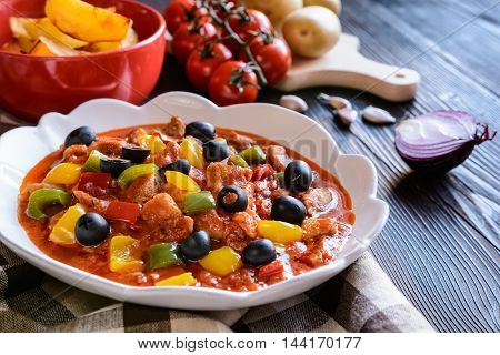 Pork Ragu With Pepper, Olives And Fried Potatoes