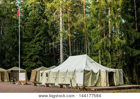 military campground in the forest at summer