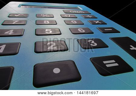 Close up macro shot of calculator. Savings calculator, finances calculator , economy and home concept. Credit card calculator. Credit card calculator. Tax calculator. Shallow Depth of field