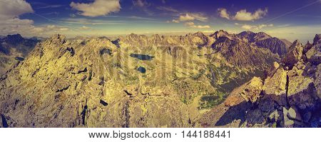 Summer mountain landscape in a panoramic photograph in vintage style. View of the beautiful valley and ponds in High Tatra Mountains Slovakia.