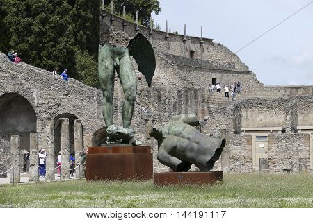 POMPEII ITALY - may 25 2016: tourist in famous antique ruins of town Pompeii Italy. Pompeii was destroyed and buried with ash and pumice after Vesuvius eruption in 79 AD.