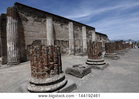 POMPEII ITALY - may 25 2016: Famous antique ruins of town Pompeii Italy. Pompeii was destroyed and buried with ash and pumice after Vesuvius eruption in 79 AD.