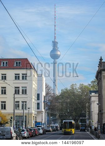 Berlin city street with the Fernsehturm TV-tower in the background.