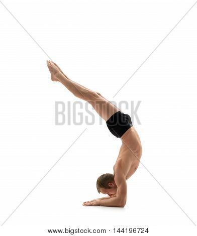 Sport. Athlete doing handstand, isolated on white background