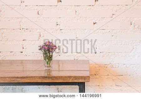 Room interior white brick wall with wooden table stock photo