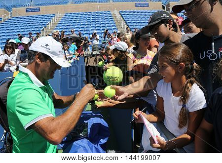 NEW YORK - AUGUST 23, 2016: Tennis coach Tony Nadal of Spain signing autographs after practice with Grand Slam champion Rafael Nadal for US Open 2016 at Billie Jean King National Tennis Center