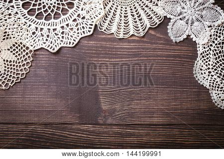 Vintage background with white crochet lace. Knitted frame for wedding and invitation. Background for valentines day or birthday
