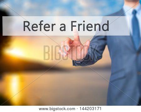 Refer A Friend -  Businessman Click On Virtual Touchscreen.