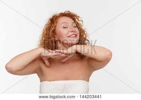 Picture of playing mature or middle aged woman expressing positive emotions isolated on white background. Indian dances concept.