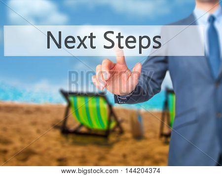 Next Steps -  Businessman Click On Virtual Touchscreen.