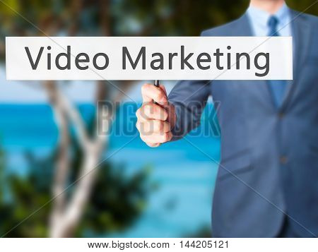 Video Marketing - Business Man Showing Sign