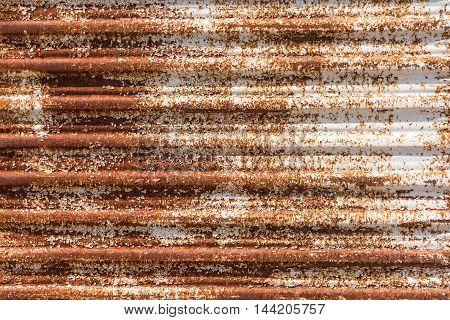 Close up of a rusty corrugated iron. Rusty corrugated iron background.