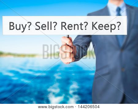 Buy? Sell? Rent? Keep? - Business Man Showing Sign