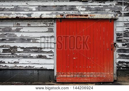 Red door and fire reel, old fire station in Wellington, New Zealand