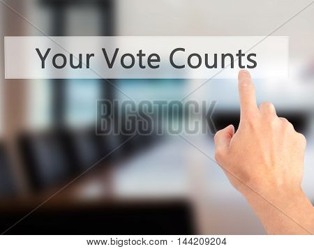 Your Vote Counts - Hand Pressing A Button On Blurred Background Concept On Visual Screen.