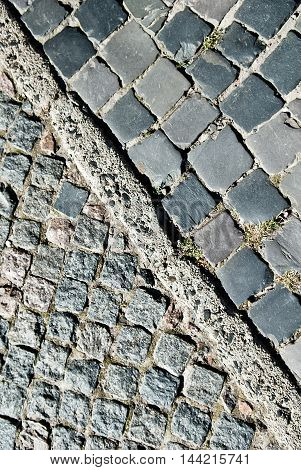 Cobblestone street and pavement texture. Diagonal separation. Abstract background of old cobblestone.