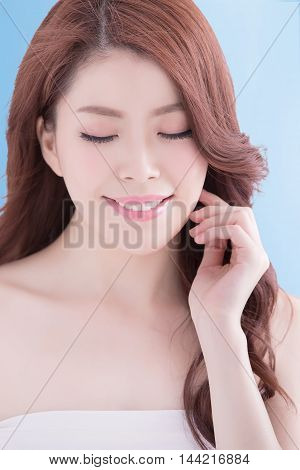 Beauty woman with charming smile to you with health skin teeth and hair isolated on blue background asian beauty
