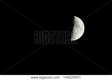The Half moon in the dark sky