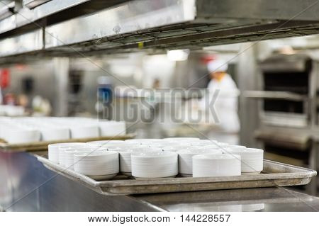 Many Ramekins on Line in Commercial Kitchen