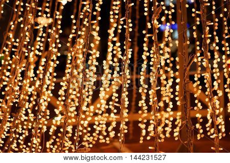 Christmas decorations in the street with golden lights