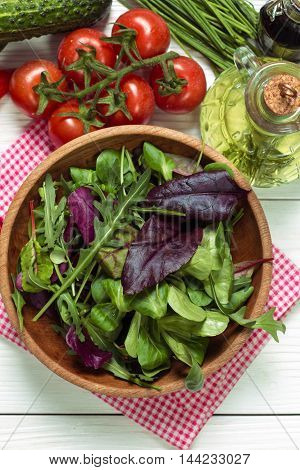 Fresh Green Salad With Spinach ,ruccola,lettuce On Wooden Table.